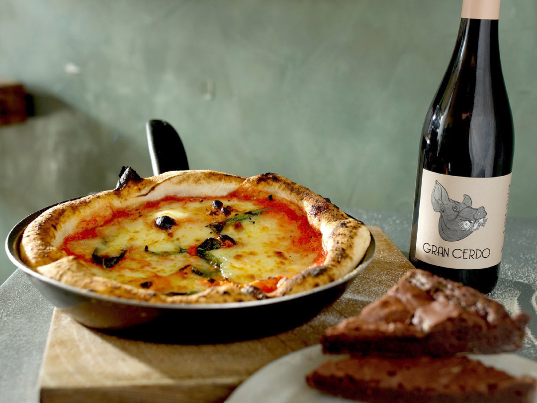 Pizzarova make your kit margherita pizza in frying pan with bottle of red wine and chocolate brownies